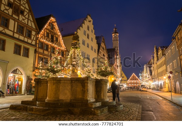 A festively decorated fountain near the Christmas market in Rothenburg ob der Tauber, Germany
