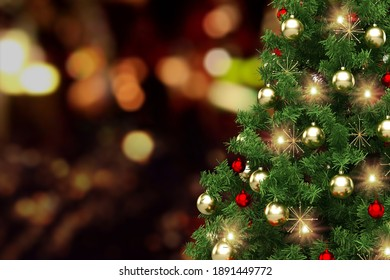 Festively Decorated Outdoor Christmas tree on blurred sparkling fairy background.