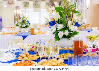 Festively laid tables at the Banquet. Various delicacies, snacks and drinks. Catering.