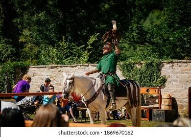 Festivities of Pernstejn Manor, medieval fair, falconer performance, bird of prey, man in historical costume, Reconstruction, medieval entertainment at castle Pernstejn, Czech Republic, 07 July, 2018