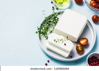 Feta cheese with herbs and olive oil. Top view, space for text.