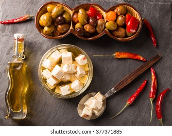 Feta Cheese and Olives on wooden background