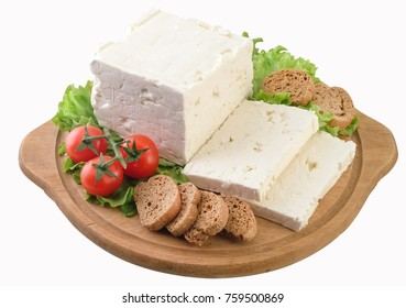 Feta cheese on wooden board,clipping path.