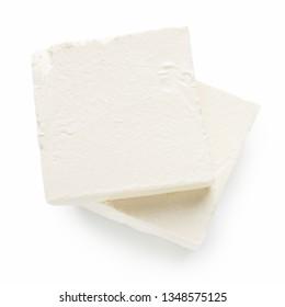 Feta cheese pieces on white background, top view