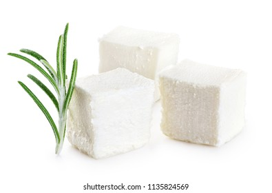 Feta cheese and rosemary isolated on white background.
