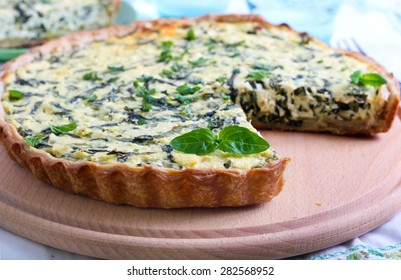 Feta cheese and spinach  tart, sliced, selective focus