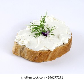 feta cheese spread with dill on a slice of bread