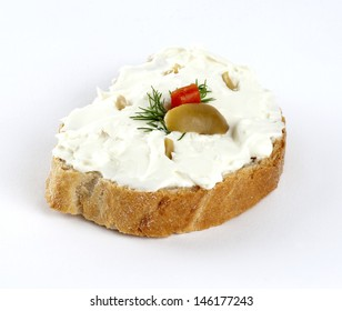 feta cheese spread mixed with green olives and dill on a slice of bread