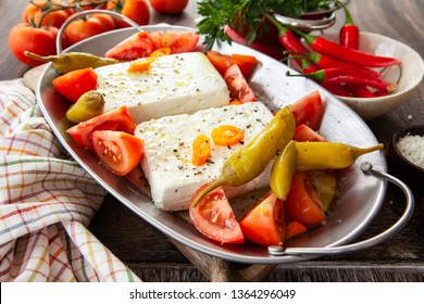 Feta cheese with tomatoes and chillis for baking in the oven or BBQ