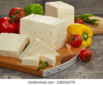 feta greek cheese on chopping board