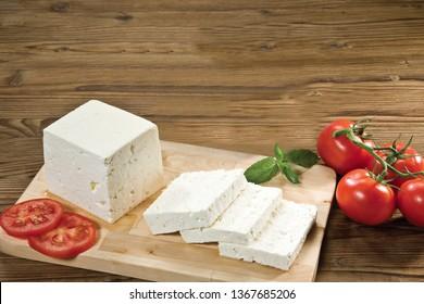 feta greek turkish cheese on chopping board white background
