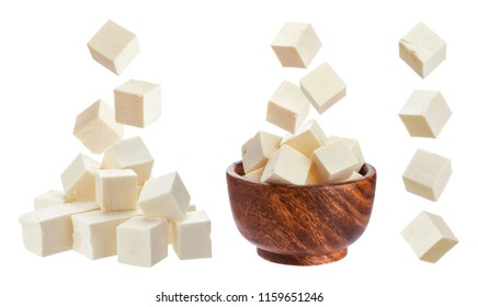 Feta isolated. Falling pieces of white cheese