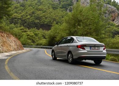 Fethiye / Turkey - 09.28.18: Fiat Egea drive by mountains serpentine