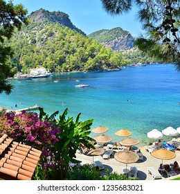 Fethiye, Turkey - August 15 2016 : Beach with surrounded by green trees