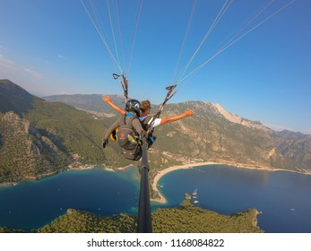 Fethiye, Turkey August 2018; Paraglider flying above Oludeniz beach in Fethiye- Turkey during sunset