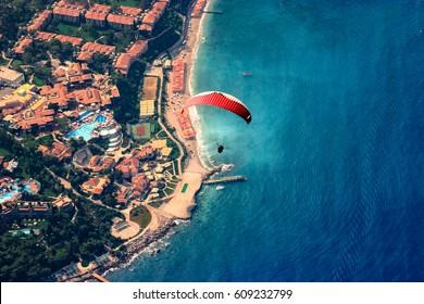 FETHIYE, TURKEY - AUGUST 27, 2008: Paraglider flying over Babadag on the background of Oludeniz Beach.