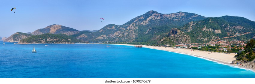 Fethiye, Turkey - May 01, 2018: Panoramic view from Kumburnu or Belcekiz Beach in Fethiye. Paragliding on Oludeniz or Olu Deniz Beach from Babadag,  Panoramic view from Fethiye Oludeniz beach Turkey.