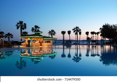 Fethiye, Turkey - May 27, 2011: View of the pool, pool bar and palm trees at sunset in hotel  Club Tuana Fethiye.