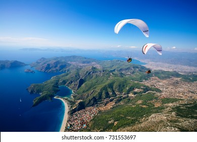 Fethiye, Turkey September 28  2008;  Paraglider flying above Oludeniz beach in Fethiye- Turkey.