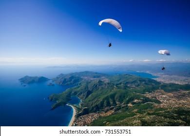 Fethiye, Turkey September 28  2008;  Paraglider flying above Oludeniz beach in Fethiye- Turkey.