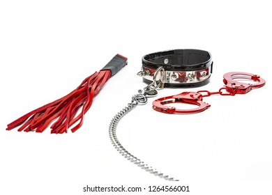 Fetish stuff: hand cuffs, flogger and collar with chain
