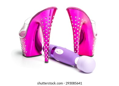 Fetish style high heels shoes in pink with platform sole, in clear plastic and rhinestone decoration together with a Body wand massager for stimulation and massage, mostly used as a vibrator sex toy.