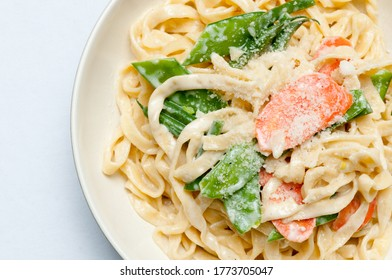 fettuccine alfredo primavera, creamy sauce with vegetables and home made pasta