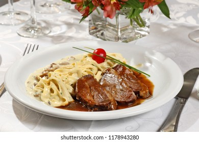fettuccine and filet with roti sauce