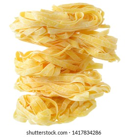 Fettuccine pasta nests close up on a isolated white background.
