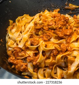 Fettuccine or tagliatelle cooked with sauce bolognese
