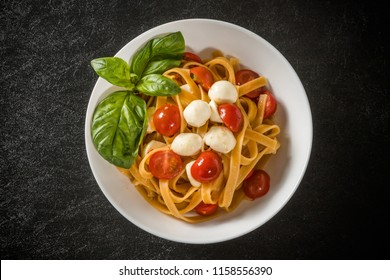 fettuccine(pasta in flat strips wider than linguine)