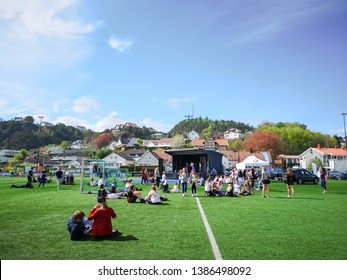FEVIK ARENDAL, NORWAY - MAY 1, 2019: People attend open-air concert in the park under the sunny day at Fevik market. Arendal.  Norway.