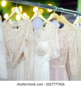 A few beautiful wedding dresses on a hanger. Bridal shopping