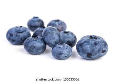 Few bilberries on the white background