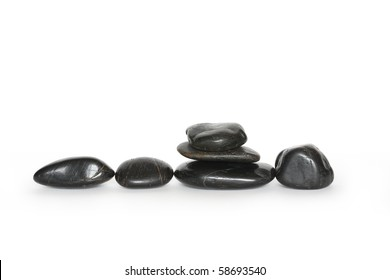 Few black stones isolated on white background with clipping path