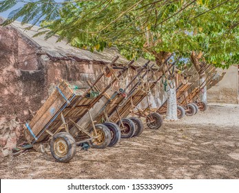 A few carts are standing next to the wall on the island Joal-Fadiouth. Town and commune is in the Thiès Region at the end of the Petite Côte of Senegal. Africa.