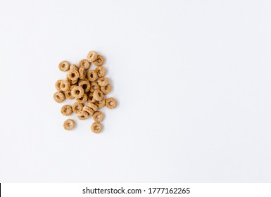 Few cheerios are scattered on white background on the right. Left blank space for signature
