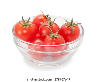 Few cherry tomatoes with leaves in glass transparent bowl isolated on white background