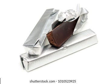 Few chocolate bars on a white background.