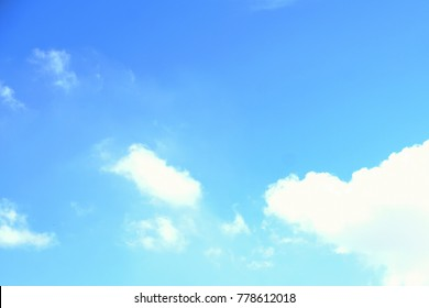 A few clouds in a blue sky