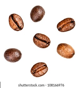 Few coffee beans. Isolated on white background