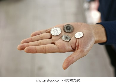 Few coins hold in open hand