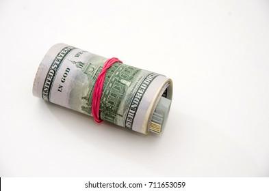 a few dollar bills in roll
