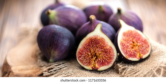 A few figs on an old wooden background.