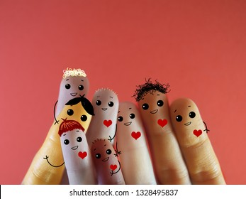 Few fingers decorated as a group of friends having happy gathering. They have different skin color but are all kind.