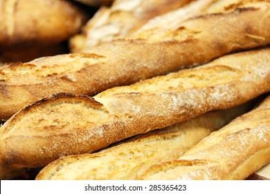 A few fresh baked baguettes. Selective focus.