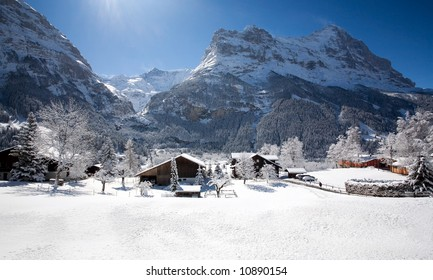 Few houses in Alpine village in Switzerland