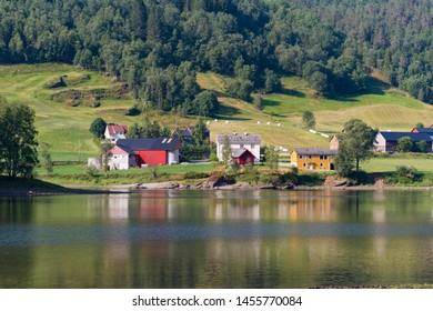 Few houses reflected in a lake in Norway