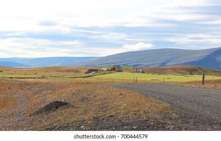 A few houses watch over this beautiful and colorful Icelandic landscape