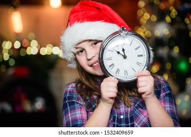 Few minutes till new year. Magic moment is coming. Girl santa claus hat and clock. Meet Christmas holiday. Festive atmosphere christmas day. New year countdown. Counting time. Christmas almost here.